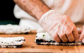 rolling salmon hosomaki sushi