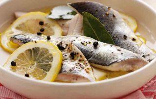 Fresh herrings in lemon